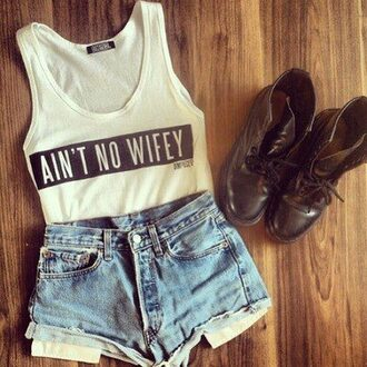 shirt tumblr tank top ain't no wifey white tank top high waisted shorts combat boots shorts shoes aint no wifey top t-shirt denim shorts black white no wifey crop tops pants blouse aintnowifey demin shorts boots blue jeans cute short fashion brown top with quote a'int no wifey style quote on it wifeyoffduty awesomness swag top cool t-shirt cream top outfit graphic tee white shirt tumblr outfit cute top nail polish aint no wifey\ white top white t-shirt blue jeans