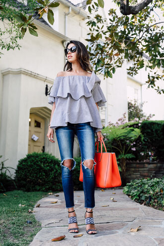viva luxury blogger jewels bag off the shoulder ripped jeans skinny jeans orange bag printed sandals top ruffled top grey top off the shoulder top jeans blue jeans ripped orange blouse high heel sandals sandals sunglasses black sunglasses spring outfits