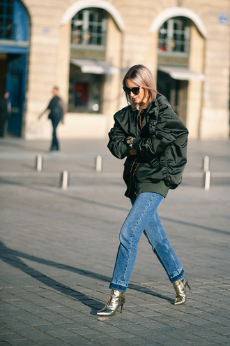 the fashion guitar blogger coat sweater jeans shoes jewels sunglasses jacket tumblr army green jacket bomber jacket green bomber jacket khaki bomber jacket oversized oversized jacket denim blue jeans boots ankle boots gold boots metallic metallic shoes high heels boots pointed boots